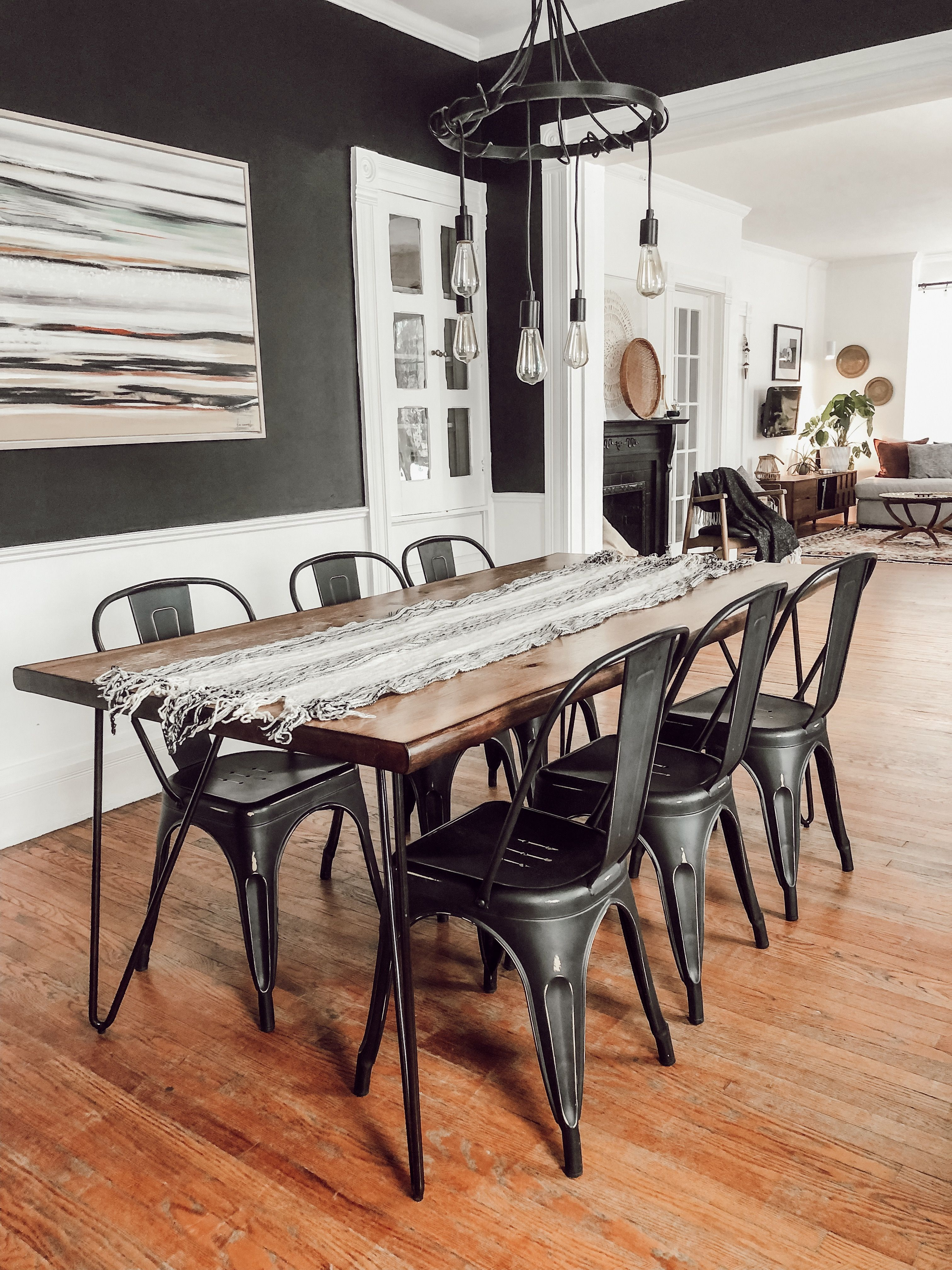 Funky Victorian Home Tour Black and white dining room with industrial, metal cha…