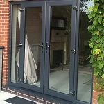 Grey French doors, love the windows next to the door. Wouldn't have to close the...