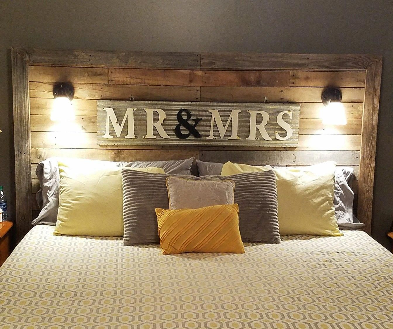 My hubby made us a king size pallet bed, added our Mr & Mrs sign, then wired our…