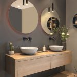 modern bathroom with floating vanity and twin sinks