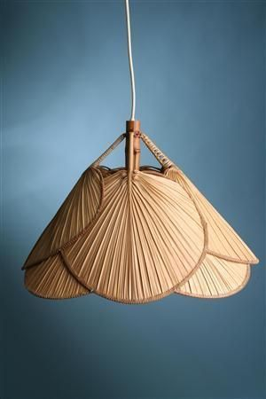 pendant light shade created from palm hand fans perfect for a boho or tropical