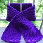 Learn to knit a keyhole scarf with this easy garter stitch pattern. This lovely ...