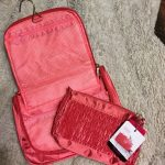 NWT  Jackie Designs makeup bag set. Gorgeous coral hanging makeup bag and small...